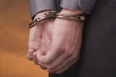 Arrested in handcuffs Stock Images