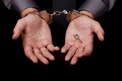 Arrested in handcuffs Stock Image