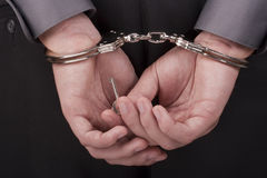 Arrested in handcuffs Royalty Free Stock Photos