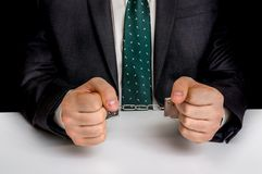 Arrested man in black suit with handcuffs Stock Photography