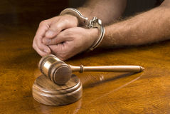 Arrested man and gavel royalty free stock photo
