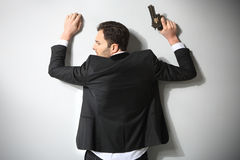 Arrested man with gun Stock Image