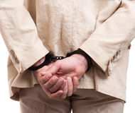 Arrested man handcuffed hands at the back Stock Photo