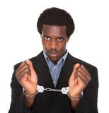 Arrested man with handcuffed hands Royalty Free Stock Photography