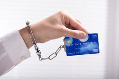 An Arrested Person Hand Linked To Credit Card. Close-up Of An Person`s Hand Linked To Credit Card stock photography