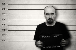 Arrested. Police mugshot of arrested criminal. Black and white image with copy space