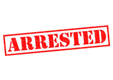 ARRESTED. Red Rubber Stamp over a white background Stock Photography