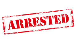Arrested. Rubber stamp with word arrested inside,  illustration Royalty Free Stock Images