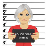 Arrested senior woman posing for mugshot holding a signboard Royalty Free Stock Images