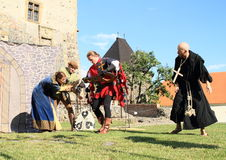 Arrested witch. Knight and priest - theater play 'The Witch' at 'Conquest of water castle Svihov' (Czech Republic, the 1st of July 2016 Royalty Free Stock Photo