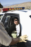 Arrested Woman Sitting In Police Car Stock Image