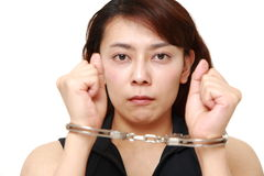Arrested woman Stock Photography