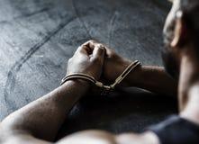 Arresterad afrikansk man med handbojor Royaltyfri Fotografi