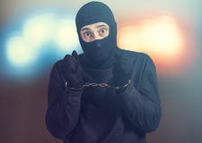 Arresterad brottsling Arkivbild