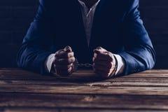 Arresterad manlig affärsman med handbojor Fotografering för Bildbyråer