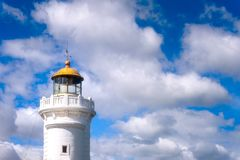 Arriluze lighthouse in Getxo with blue sky with clouds. At daylight stock images