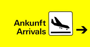 Arrival. Board at the airport in german and english royalty free stock image
