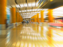 Arrival. Zoomed sensation onto a group of men in an airport's arrival's hall Royalty Free Stock Photos