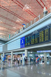 Arrival area with flight schedule board, Beijing Capital International Airport Stock Photos