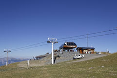 Arrival of cable car at Chamrousse resort. CHAMROUSSE, FRANCE, August 21, 2017 : At the top of Chamrousse mountain resort, the arrival of cable car and ski Royalty Free Stock Image