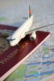 Arrival/Departure. Toy plane on passport and map of Paris Stock Photography