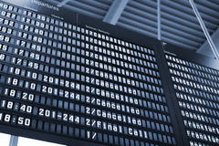Arrival Departure Board. At Warsaw Airport Stock Photo