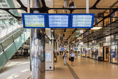 Arrival Departure Board at new back entrance of Amsterdam Central Railway Station. Amsterdam, Netherlands . The new back entrance opened in 2015 Royalty Free Stock Images