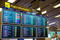 Arrival Departure Board showing departing flights in Changi Airport, Singapore. Royalty Free Stock Images