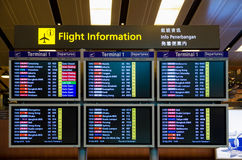 Arrival Departure Board showing departing flights in Changi Airport, Singapore. Stock Images