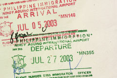 Arrival departure passport stamps Stock Images