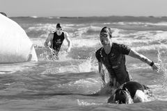 Arrival of the first athletes at the end of the swimming test at Ironman 70.3 in Pescara. Pescara, Italy - June 18, 2017: Arrival of the first athletes at the Stock Photos