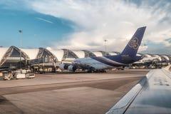 Arrival flight on runway in morning at Suvarnabhumi international airport. Bangkok, Thailand - Oct 25 2018 : Arrival flight on runway in morning at Suvarnabhumi royalty free stock photos