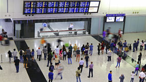 Arrival hall hong kong international airport. Passengers at the terminal 1 arrival hall of hong kong international airport Royalty Free Stock Image