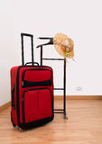 Arrival in hotel - clothes Valet Garment Stand with suitcase and. Summer holidays start! Sunhat and suitcase with clothes rail Stock Photos