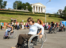 Arrival of invalids on wheelchair. Royalty Free Stock Photos