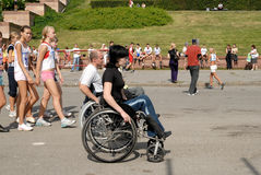 Arrival of invalids on wheelchair. Royalty Free Stock Photography