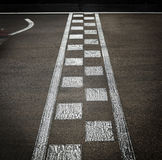 Arrival line in a motor race. Arrival line in a motor circuit in black and white Stock Photography