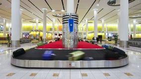 The arrival of luggage on the carousel at dubai international airport dubai stock video