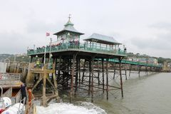 Ship arriving at Victorian pier Stock Photography
