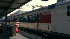 Arrival of passenger train on railroad station. Arrival of modern passenger train on railroad station stock footage