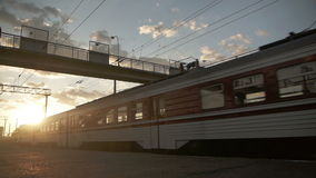 Arrival of passenger train on railroad station. Arrival of old passenger train on railroad station stock footage