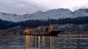 Arrival At The Port Of Ushuaia. Ushuaia is the capital of Tierra del Fuego, Antártida e Islas del Atlántico Sur Province, Argentina. It is commonly regarded stock video footage