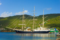 The arrival of the sailing ship tenacious in the windward islands. An historic british tall ship used for the training of sailors visiting port elizabeth, bequia Stock Images