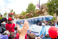 Arrival of Santa Claus. Adelaide, Australia - November 12, 2016: Spectators cheer at the long awaited arrival of Father Christmas at the 2016 Credit Union Stock Image