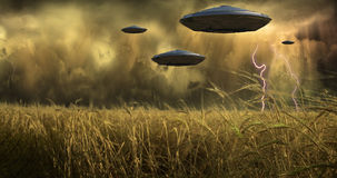 Arrival. Saucer Ships hover above field royalty free illustration