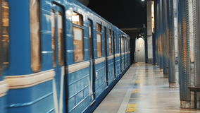 Arrival of the subway train in Gagarinskaia station, Novosibirsk, Russia. Passengers enter. And leave underground carriage. Attention the doors are close and stock footage