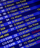 Arrival Times At An Airline Counter Stock Photos