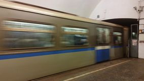 The arrival of the train at the platform. MOSCOW, RUSSIA - FEBRUARY 07, 2017: Passenger train arriving at the station of the Moscow Metro stock footage
