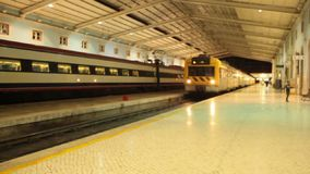 Arrival of the train at the station in Lisbon. Santa apolonia stock video footage