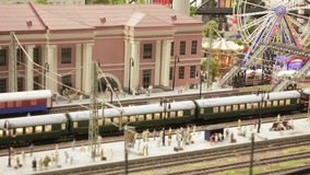 Arrival of train at station. ST. PETERSBURG - JULY 2016: Arrival of train at station in small city, Russia. The Grand Maket, which opened in 2011, is a 1:87 stock footage